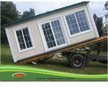 Modified container house with a truck/ movable prefabricated container with wheels /cheap prefab shipping container home