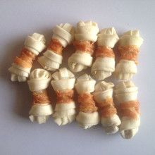 white rawhide knotted bone Dog Treat with chicken