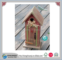 Cute decorated and colorful wooden bird cage hanging wooden bird house
