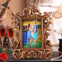 2015 hot sale resin modernphoto frame new models Golden mini muslim photo frame high quality 4x6 hollow out 0.6kg hand curved