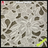 Alibaba China lace fabric market in dubai, 100poly lily design water soluble embroidered lace for apparel, clothing