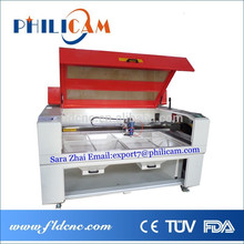 de la fábrica de china baratos directa venta caliente tela/acrílico/madera/granito co2 láser de corte máquina de grabado