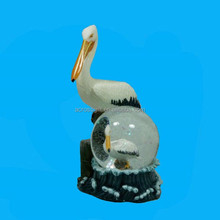 Polyresin pelican animal figurine w water ball