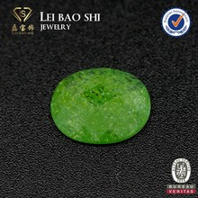 Synthetic oval light green faceted snowflake gemstone