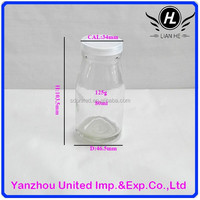 Wholesale small capacity clear glass milk bottle with plastic lid