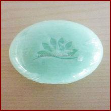 Oval Transparent shape with logo inside hotel soap bar