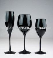 black flute and round wine glass