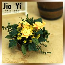 رفعت الصفراء زهرة صغيرة الطين الاصطناعي الزهور الزخرفية بيت الدمى