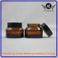 Wholesale empty 50g slant shoulder amber cosmetic cream glass jar with black cap