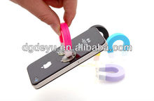 Promotional cell phone holder for universal phone cord wrap holder