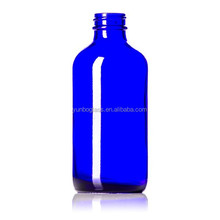 Fast delivery 8 oz Cobalt Blue Glass Boston Round Bottle for storing personal care products as well as essential oils.