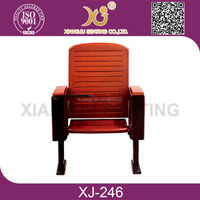 comfortable wooden auditorium chair with writing tablets