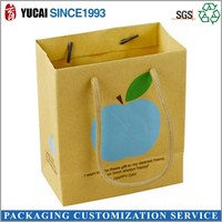 Blue apple design yellow paper bag shopping bag
