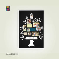 "black wooden family tree photo frame with word ""family"""