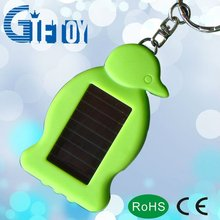 cute penguin shaped led solar keychain for promotional gift