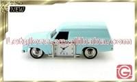 Polished zinc alloy travelling car shaped vintage desk clock