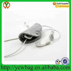 Wool felt earphone organizer with button closure