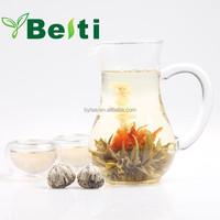 Beautiful artistic blooming jasmine flower tea made of Chinese organic green tea and flower calendula EU standard