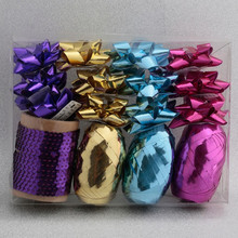 Christmas gift wrap set with star bow and curling ribbon egg