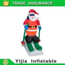 giant Christmas inflatable santa with rapid ski