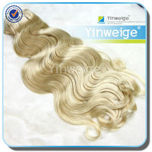 curly blonde clip in hair extensions #613 light blonde