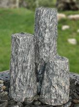 Fuente de agua en piedra para jardines y exteriores