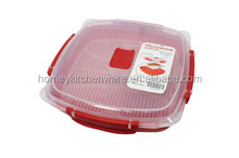 Red color plastic rice steamer in micrrowave oven