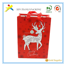 Cheap fancy christmas packaging paper gift bag with handles,christmas gift paper bag