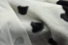 spotted dog design faux fur fabric
