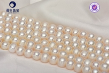 Similar round fresh water pearls in strands for sale