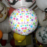 Colorful dots in round fire retardant paper lantern in paper crafts