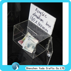 Clear Acrylic Suggestion and Donation Box With Open Lids and Lock in the right hand