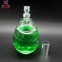100ml egg shape glass atomizer spray glass perfume bottle for ladies manufacturer made in china