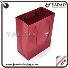 Custom red cardboard shopping bags with debossed logo and high quality cord used for shop favors jewelry bags