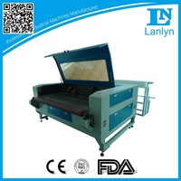 China Supplier RS1610T High Efficiency Smooth Cloth Auto Feed CO2 Laser Cutting Machine