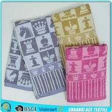 Soft terry colored yarn woven bath towel yarn-dyed woven brand logo satin border bath towel