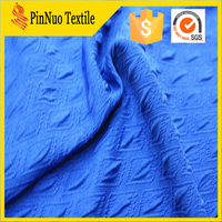 2015 hot sale order price polyester royal blue jacquard jersey knit fabric