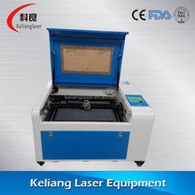 Manufacturers sell the latest CNC mini laser engraving machine