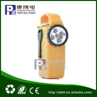 Portable hand crank solar torch with radio