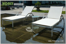 Outdoor chaise lounge with side table