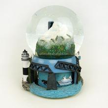 Custom polyresin base crystal ball city and ocean Resin snow globe