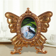 Golden decor resin butterfly shape curved photo frame 0.2kg polished spray painted high quality small picture frame home favor