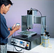 Automatic gluing equipment for epoxy sealant . Automatic gluing device for epoxy sealant