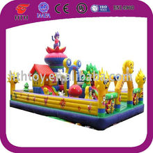 Attractive happy Angle kids playing giant inflatable fun city
