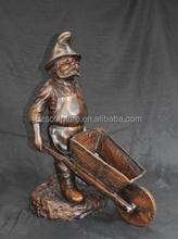 garden funny gnome bronze sculptures pushing a small tool car