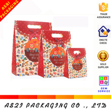 OEM orders can be accepted most popular colorful printed punch handle die cut bag for gifts die cut bag