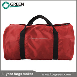 Red small waterproof dry bag use in beach