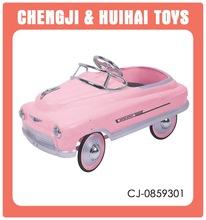 Vintage design pink children metal pedal car