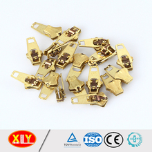 sell by KG #4.5 brass yg spring lock zipper slider for big quantity clothes