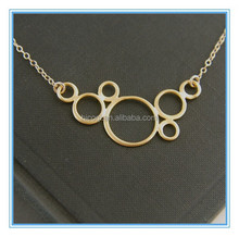 stainless steel gold plated connected circles and gold filled necklace